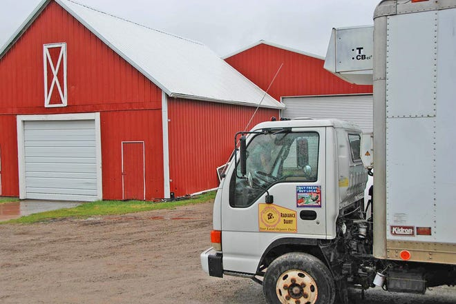 A delivery truck parked outside a red barn at Radiance Dairy in Iowa promotes buying local. Owner Francis Thicke has been running the small organic grass dairy and selling products direct to consumers for the past 30 years. He recently penned a letter to Secretary of Agriculture Tom Vilsack calling on USDA to enforce stricter organic standards.