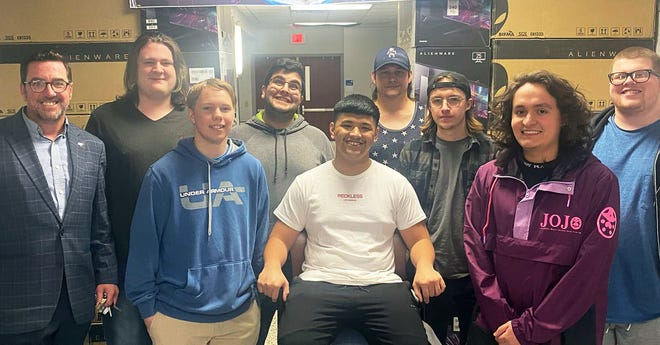 Adviser Christopher George, left, is pictured with the Amarillo College Esports varsity Overwatch team.