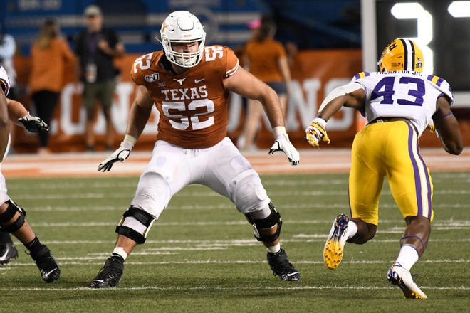 Texas left tackle Samuel Cosmi (52) blocks in the second half against LSU during their game on Sept. 7, 2019 at Royal-Memorial Stadium. [SCOTT WACHTER/USA TODAY]