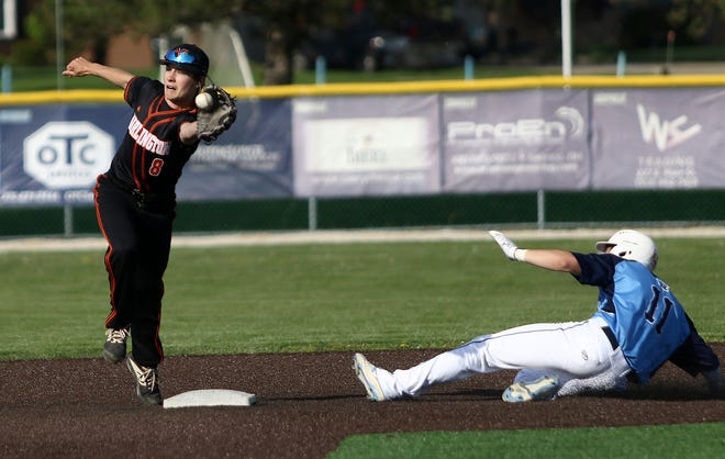 Marlington's Nate Johnson gloves the throw to second base as Louisville's J.T. Popick (11) slides safely into the bag.