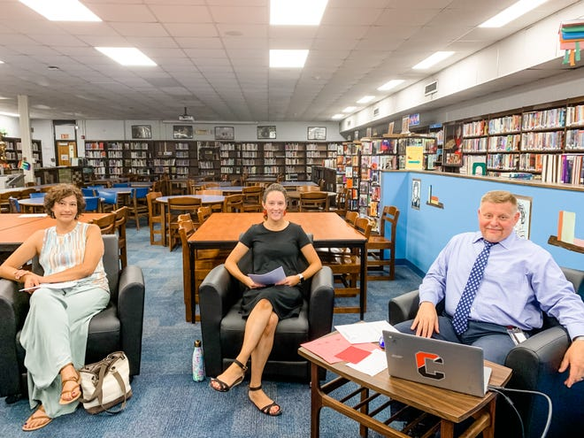 Current Cinnaminson Middle School Assistant Principal Kristin Melcher, center, welcomes new teachers during a staff orientation.