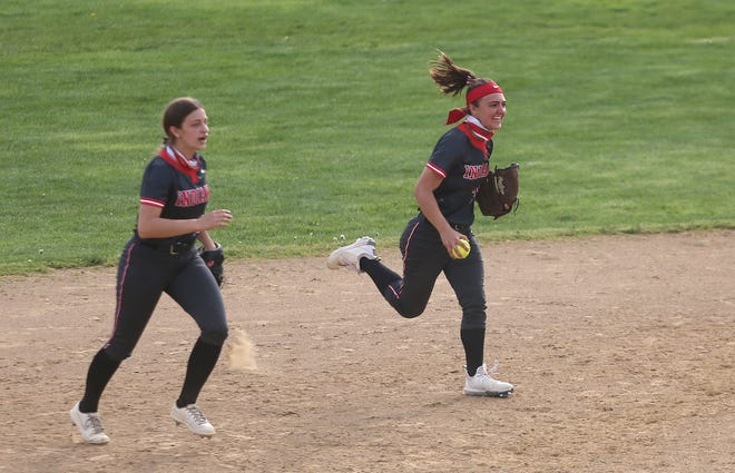 West Allegheny's Allie Gass (right) smiles as she runs off the field after she caught a pop fly resulting in the end of the seventh inning and West Allegheny's 5-4 Victory of the Chartiers Valley Colts Wednesday evening at West Allegheny High School.