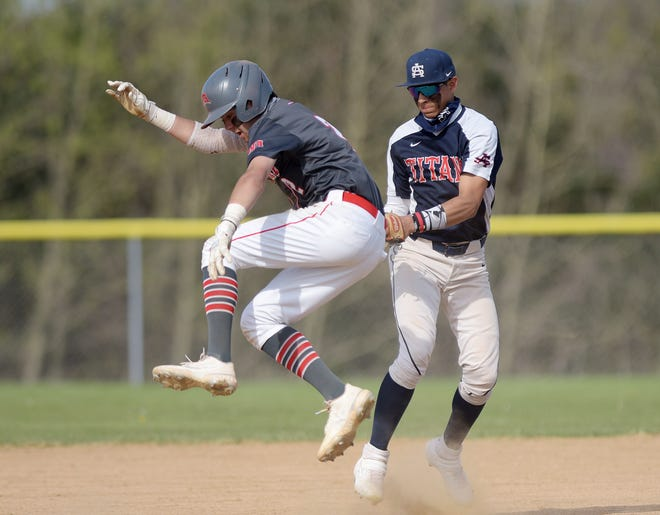 Shaler's Bryan Rincon tags West Allegheny's Dylan Grass during Tuesday's game at Donaldson Park in North Fayette Township.