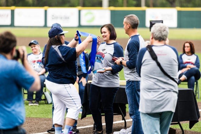 Bartlesville school district honors teachers at baseball park