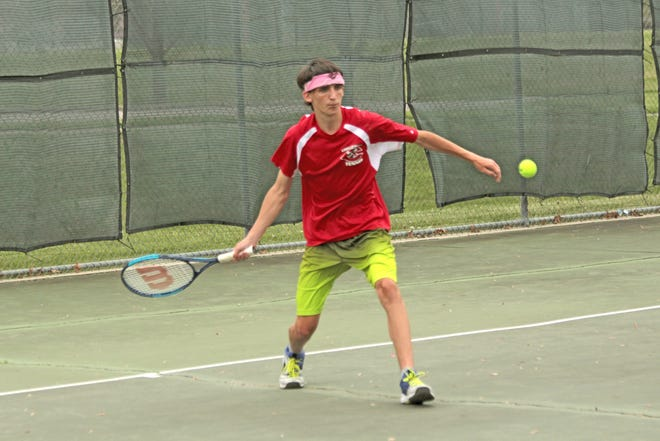 Senior No. 2 singles player Caleb Corbin of the Chillicothe High School tennis Hornets steps into a forehand shot during the first game of his set against Gavin Pike of Kirksville at the Daryl Danner Memorial Park lower courts Tuesday,. Corbin defeated Pike for a second time in as many meetings, this time 8-4, but KHS won the team dual, 5-4.