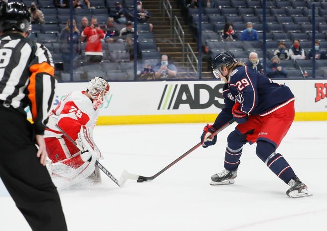 Blue Jackets right wing Patrik Laine scores on Detroit goaltender Thomas Greiss during a shootout Tuesday. Laine is 11-for-22 in shootouts in his career.