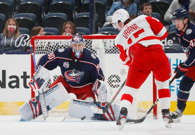 Columbus Blue Jackets goaltender Elvis Merzlikins (90) eyes a shot from Detroit Red Wings forward Jakub Vrana (15) during the first period of the NHL hockey game at Nationwide Arena in Columbus on Tuesday, April 27, 2021.