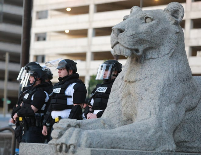 Police guard Columbus Police Headquarters as several hundred people protested the death of Minneapolis resident George Floyd in downtown Columbus on Friday, May 29, 2020.