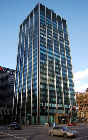 Chase plans to vacate its office space in its Downtown tower, leaving only the sign and the bank branch.