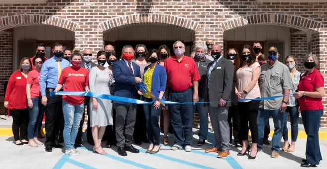 James Matassa cuts the ribbon on his new State Farm office at 403 Highway 308 in Thibodaux.