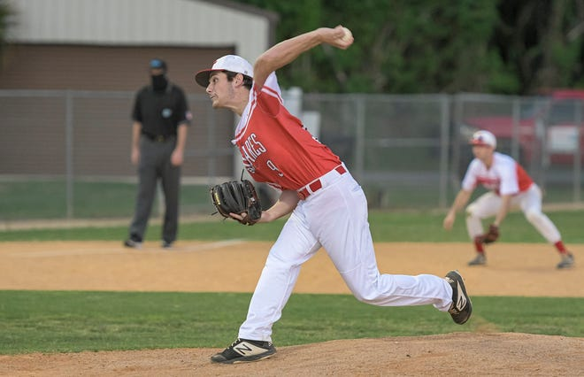Tavares relief pitcher Sam Grice works during Tuesday's Class 4A-District 5 quarterfinal game Leesburg at Fred Stover Sports Complex in Tavares. Grice had a home run and picked up the win. [PAUL RYAN / CORRESPONDENT]