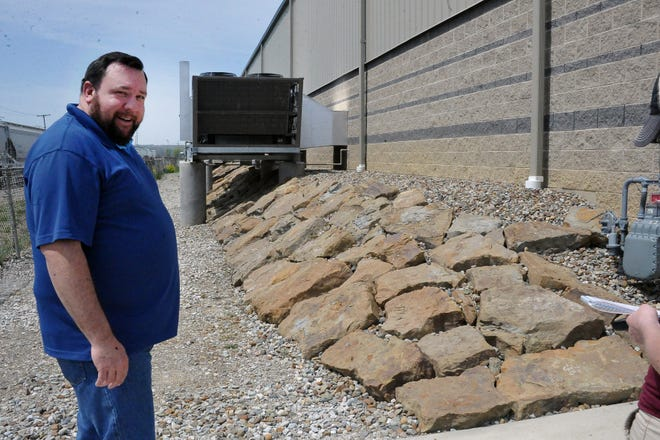 Wayne County Fair Board Secretary Matt Martin shows the new retaining wall on the side of the Event Center to keep the building's foundation secure and prevent erosion.