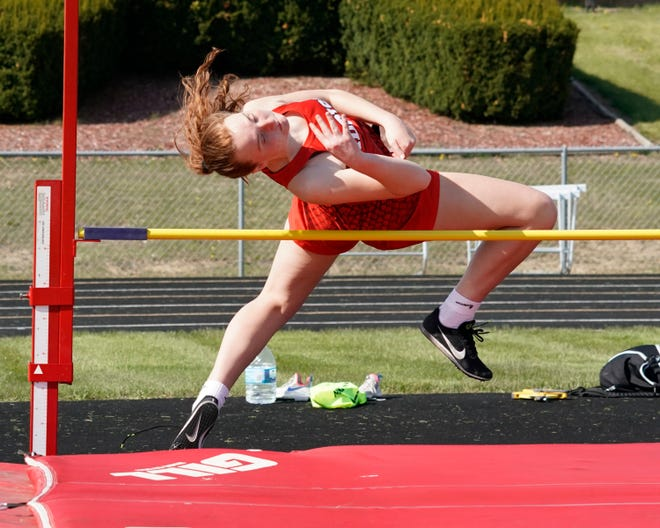 Addison's Gina Hanson clears the bar in the high jump event at Tuesday afternoon's Cascades Conference dual meet against Hanover-Horton. Hanson won the event with a height of four feet, eight inches.
