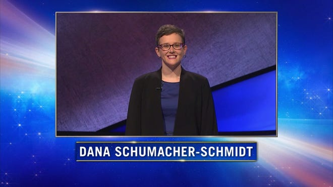 "Tecumseh resident and Siena Heights University associate professor of English Dana Schumacher-Schmidt is introduced during Tuesday's episode of the game show ""Jeopardy!"". As a newcomer to the show, Schumacher-Schmidt won Tuesday's episode with a total of $20,600."