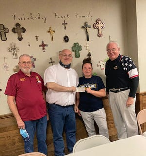 """American Legion Post 47 Commander Chris Self recently presented a $500 check to Friendship Feast kitchen manager Sarah Speakman. Friendship Feast furnishes cooked meals each weekday, Monday through Friday. Volunteers serve meals from 11:30 a.m. to 1 p.m. at the First Presbyterian Church, 803 Central Ave. in Dodge City. """"Friendship Feast is pleased to accept American Legion's donation,"""" Speakman said. """"It's generous contributions like this that allow us to serve veterans and others in the Dodge City community."""" Self added, """"Post 47 appreciates that Friendship Feast provides meals to veterans and others. The American Legion was founded in 1919 on four pillars: Veterans Affairs & Rehabilitation, National Security, Americanism, and Children & Youth. This contribution is made in support of the Legion's pillars and goals."""""""