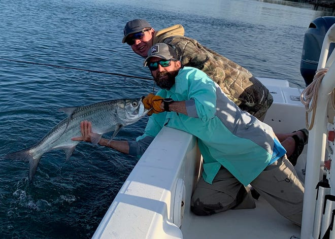 Capt. Jason with the first tarpon of the year with Capt. Fred Robert.