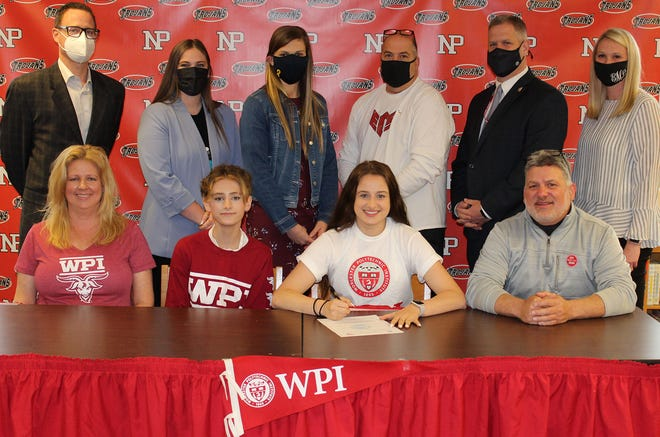 North Pocono's Jenna Beach recently committed to continue her academic and basketball careers at Worcester Polytechnic Institute. On hand to commemorate her decision were members of her family, coaches, and administrators. Pictured are (front row, from left): Lorrie Beach, Aaron Beach, Jenna Beach, Jeffrey Beach Standing are: Bryan McGraw, Superintendent; Rory Jordan, assistant coach; Lauren Carra, head girls basketball coach; Jay Schieber, AAU coach; Dan Powell, Assistant Superintendent; Eliza Maganzini, Athletic Director.