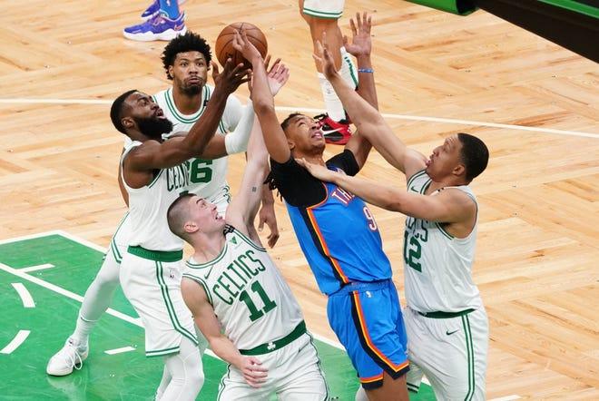 Apr 27, 2021; Boston, Massachusetts, USA; Boston Celtics guard Jaylen Brown (7) grabs the rebound against Oklahoma City Thunder center Moses Brown (9) in the second quarter at TD Garden.