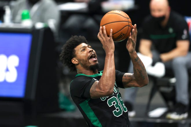 Apr 25, 2021; Charlotte, North Carolina, USA; Boston Celtics guard Marcus Smart (36) shoots against the Charlotte Hornets in the second half at Spectrum Center. The Charlotte Hornets won 125-104.
