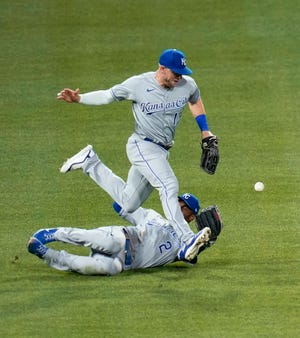 Kansas City Royals left fielder Hunter Dozier, top, and center fielder Michael A. Taylor can't come up with the fly ball by Pittsburgh Pirates pinch hitter Wilmer Difo that fell in for a hit to score Jacob Stallings in the seventh inning of Tuesday's game in Pittsburgh. The Pirates took a 2-1 lead on the hit and held on for a 2-1 victory, snapping the Royals' five-game winning streak.
