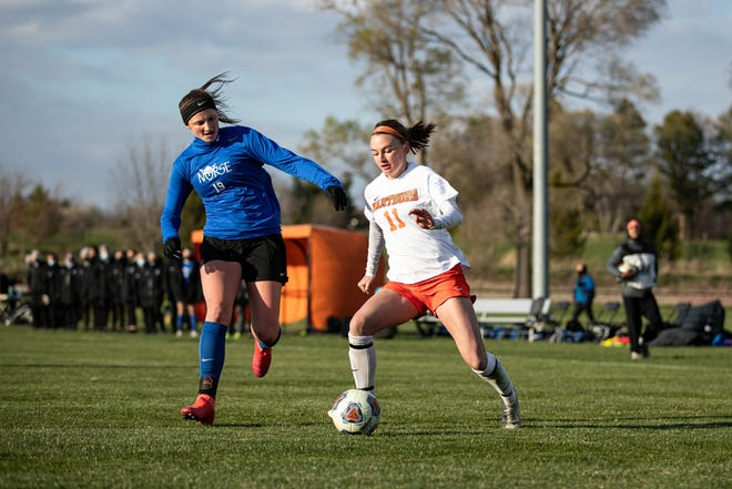 Wartburg College junior forward Kate Luers (11), a graduate of Danville High School, dribbles the ball up the pitch in a match against Luther College.