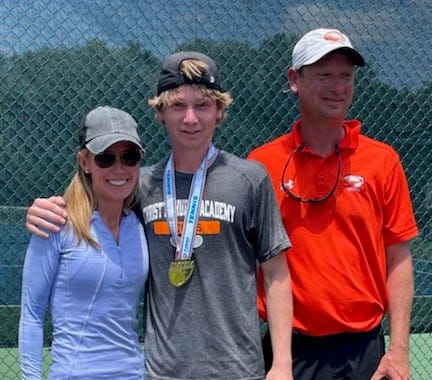 Christ's Church sophomore Chase Healey (center) celebrates with parents Nicole and Art Healey after winning the Class 1A boys singles tennis championship on Wednesday.