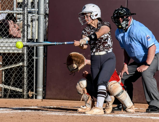 Garden City High School's Kamryn Foster connects with a Liberal pitch for a single Monday at Tangeman Sports Complex.