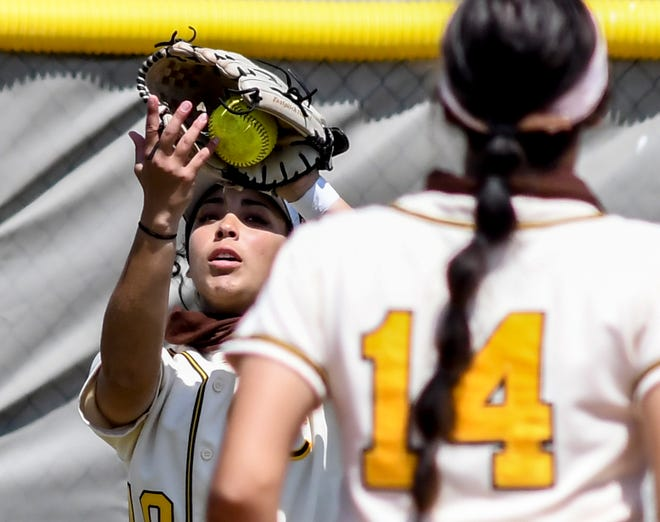 Garden City Community College centerfielder Monet Martinez squeezes the ball into her glove as she makes an out off a Colby fly ball Saturday at Tangeman Sports Complex.