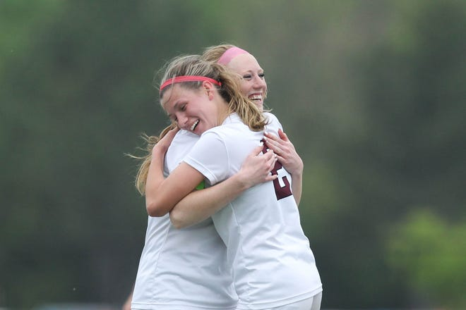 Buhler's Amaleigh Mattison (2) embraces Hali Eddy after Eddy makes her first appearance of the season on the pitch. The Crusaders beat Wichita Collegiate 4-1.