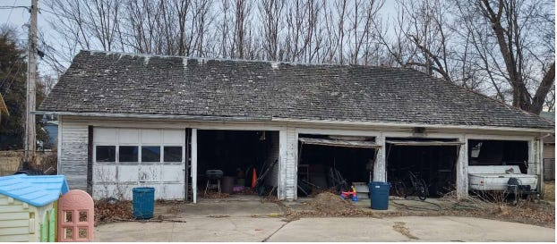 This garage, which was listed as contributing building in a historic district, will be demolished after approval by the city commission.