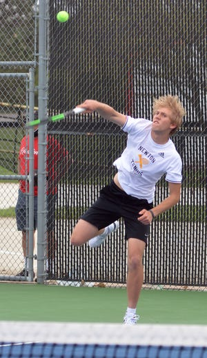Newton High School tennis player Zeke Thompson competes in doubles play during the Hesston Invitational II in Hesston.