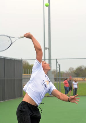 Newton High School tennis player Max Musser competes in doubles play during the Hesston Invitational Tuesday. The Railers tied for first in the 13-team tournament.