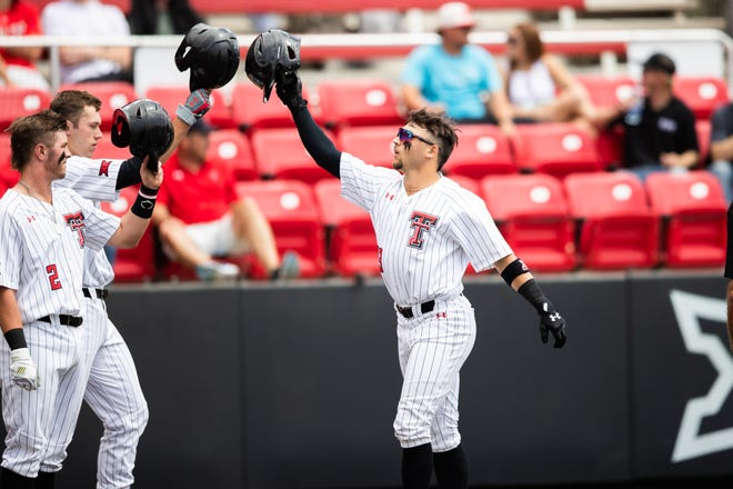 Texas Tech's Cal Conley (right) celebrates with teammates following a two-run home run in the first inning during a nonconference game Wednesday against New Mexico at Dan Law Field at Rip Griffin Park.