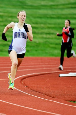 """Seen running with a comfortable lead late in the 800-meters run in a meet in Chillicothe on March 30, Brookfield High School junior Alexandra """"Alex"""" Sharp swept the 800, 1,600, and 3,200 races in last Tuesday's Gerald Mansfield Invitational/Macon Open track-and-field meet. She was the meet's top girls' points scorer."""