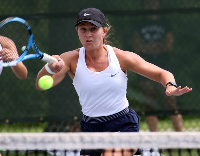McKeel's Neleah Neiberline hits a forehand during her No. 1 doubles match with Eva Harris against Gainesville Eastside's Rachel Turney and Varija Mai in the team competition of the 2021 Class 2A Tennis Finals in April at Red Bug Lake Park in Casselberry. Neiberline and Harris won 6-0, 6-1.