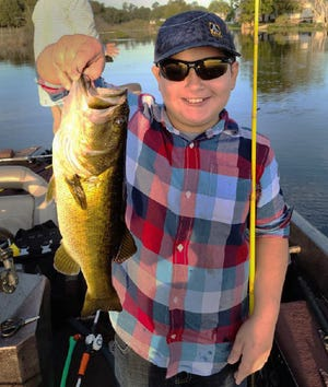 Joshua Contreras, 10, of Dundee, caught this largemouth bass on a live shiner while fishing at Crooked Lake recently.