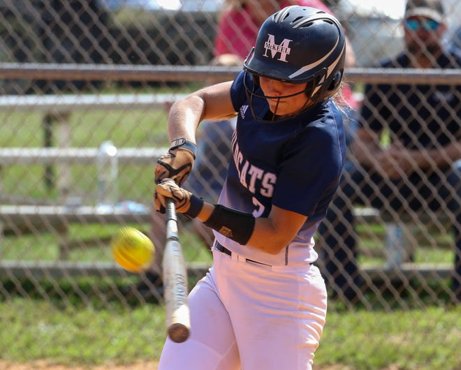 McKeel senior shortstop Charli Warren rips a double to the wall to clear the bases, barely missing a grand slam against Tenoroc durign the district tournament. In the first inning, she led off the game with a home run.