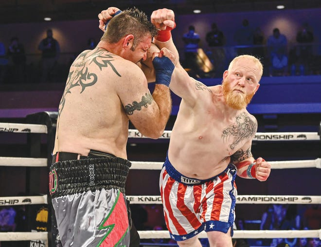 """Sam """"Hillbilly Hammer"""" Shewmaker (right), a lake local from Gravois Mills,  lands a blow in his most recent Bare Knuckle fight."""