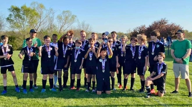Shown is the Leavenworth United Soccer Club U14 team following their first-place finish at the Challenger Cup.