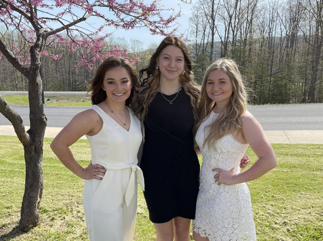 2021 Katharine Church nominees Carlie Del Signore, Virginia Breedlove and Sierra Hester pose for a photo on the front lawn of Keyser High School.