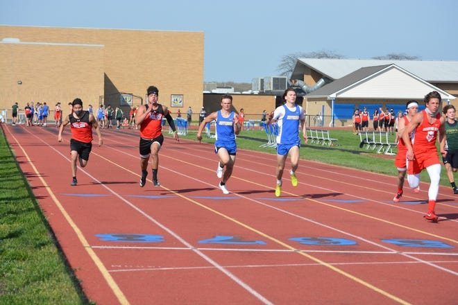 Runners compete in the 100-meter dash at the Jefferson Quad Tuesday. From left to right: Milan's Ayuub Amin and Cole McElvany, Jefferson's Jacob Priester and Jackson Barath, Grosse Ile's Will Davis and Joey Pizzo, and St. Mary Catholic Central's Cole Jondro.