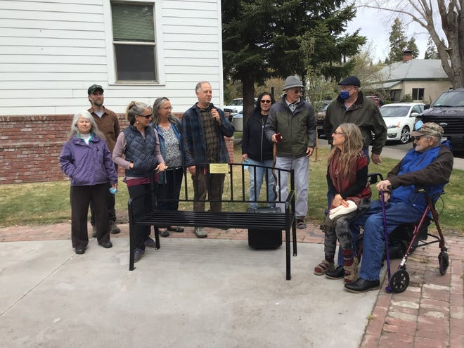 Pictured left to right at a dedication for a bench in honor of the late Dave Pearce are Geneva Omman, Ray Strack, Angelina Cook, Monica Zinda, Mary Jackson, Bob Hall, Jim Taylor, Vicki Gold, and Jim Gubetta.