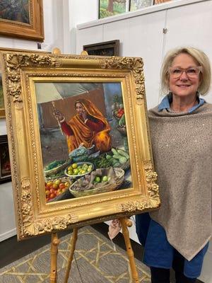 "Oklahoma City artist Diana Robinson with her painting  ""Lady Street Vendor."""