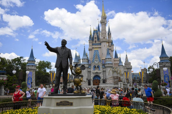 """The """"Partners"""" statue sits in front of Cinderella's Castle at Magic Kingdom on May 1, 2019, at Disney World in Orlando, Florida."""