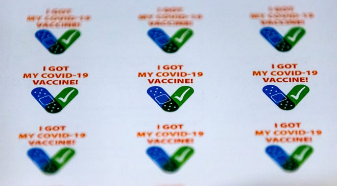 COVID-19 vaccine stickers given out by the Cleveland County Health Department in January 2021.