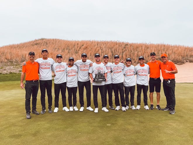 Oklahoma State celebrates with the Big 12 men's golf championship trophy on Wednesday at Prairie Dunes in Hutchinson, Kansas.