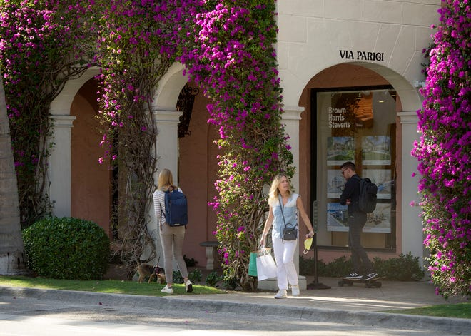 A shopper pauses on Worth Avenue Thursday. Retailers are happy with the outcome of the past season, which many say exceeded expectations. Laurel Baker, CEO of the Palm Beach Chamber of Commerce, said the arrival of new restaurants, art galleries and expansion of outdoor dining helped the town.