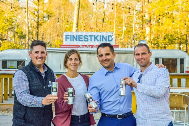 Island District Company had a launch party this week at Smuttynose Brewery. Pictured are Andy Hart, of Smuttynose, Kayla O'Connor and Jay Scully, co-founders of Island District Company, and Steve Kierstead, CEO of Smuttynose.