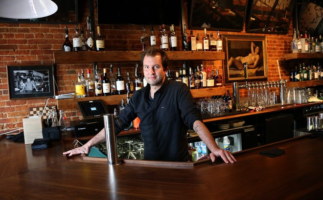 Tristan Law, operating partner of The Press Room, stands behind the bar of the well-known Portsmouth establishment, which is opening next week.