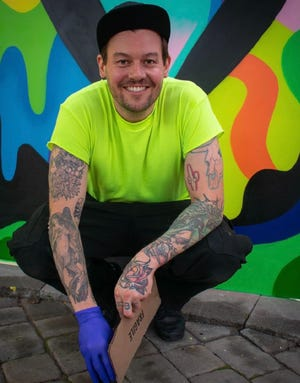Jason Naylor is an award-winning street artist who is known for creating large, colorful murals with uplifting, inspirational messages of love and positivity. His work is now on display at The Backyard in Hampton.